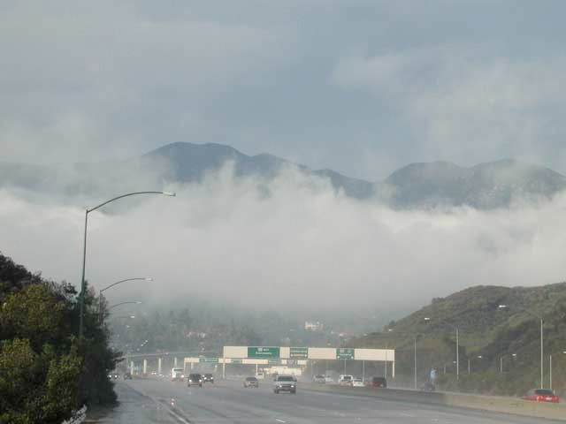 fog hovers over 8-lane freeway in California