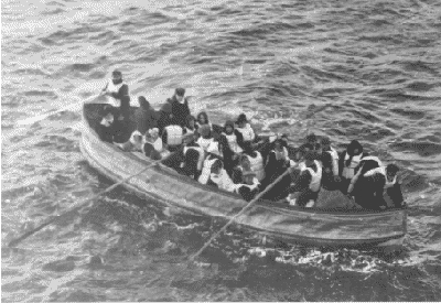 Black and white photo of small crowded boat with oars on open water, holding up to 25 people.
