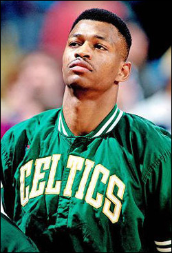 Young African American basketball player in Celtics jacket looks pensive