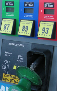 Close-up of gas pumps with 'Contains 10% ethanol' sticker