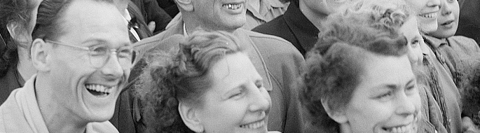 black and white photo from 1954 shows crowd of German people smiling and laughing