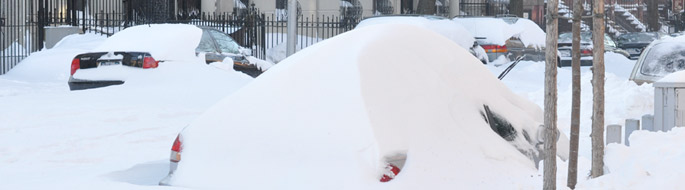 snow-covered/buried cars in street