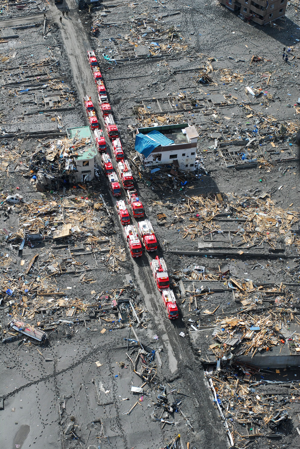 Nuclear Nightmare In Japan The Why Files Inside A Power Plant Diagram 18 Fire Trucks Two Rows Drive Down Street Debris And Destroyed Buildings Line