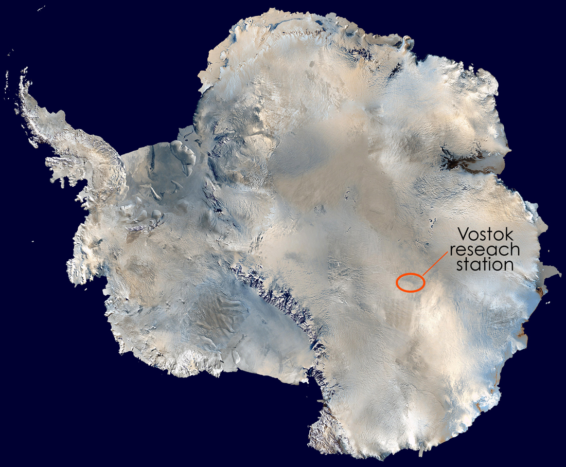 Satellite map of Antarctica, surrounded by glacial ice, Vostok station in central east
