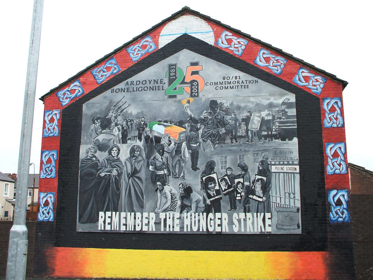 Mural painted on side of building with various protest scenes, says Remember the Hunger Strike