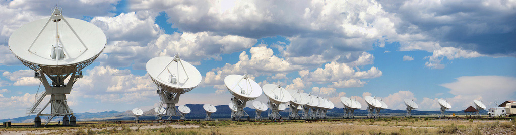 24 large radio telescopes point at the sky in daytime