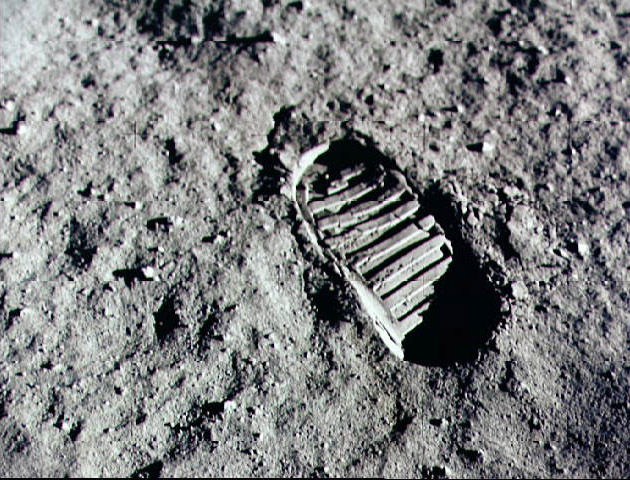 Barren surface of the moon shows an elevated boot-print