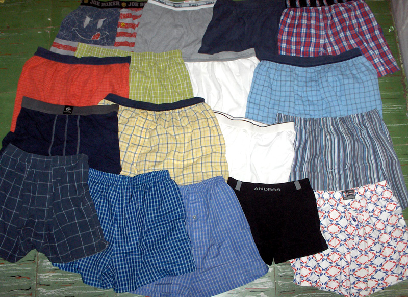 Seventeen pairs of men's boxer shorts are laid out neatly on the floor