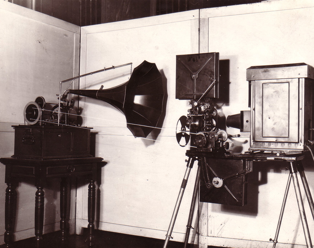 Black and white image of a three-piece apparatus with a reel and horn