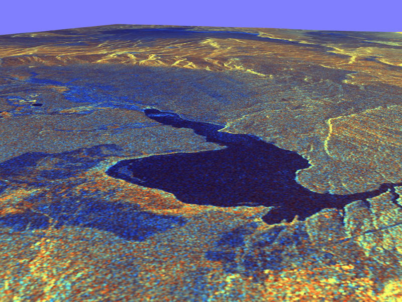 False-colored image shows lake amidst ring of hills