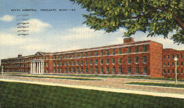 Old postcard shows wide, 3-story brick building