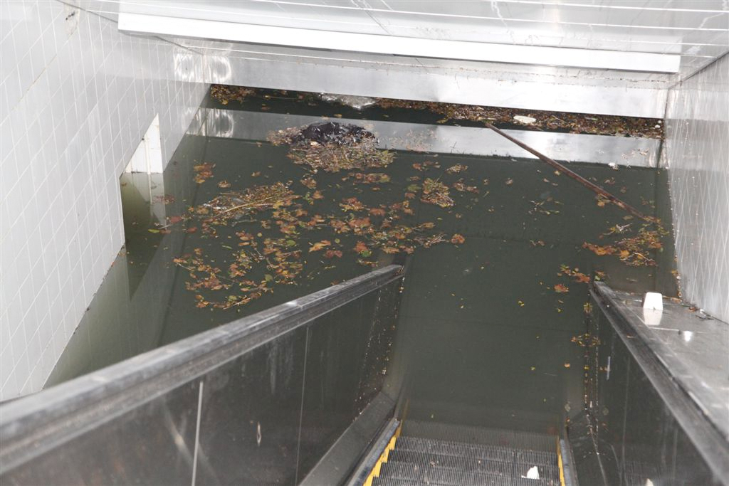 subway completely flooded as evident by water visible on highest staircase from the street.