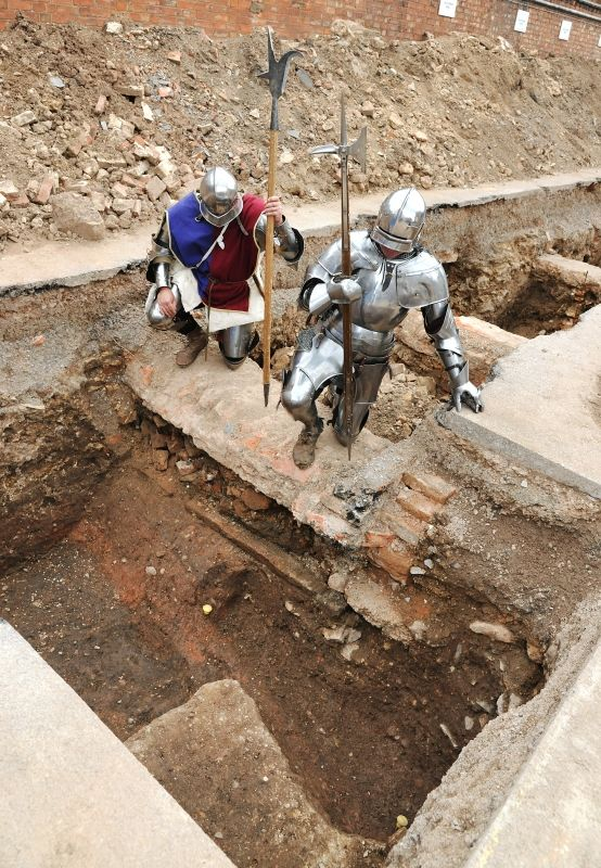 Two medieval re-enactors stand at the spot that Richard III's remains were found