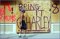Plywood covers buildings spray-painted, 'bring it Charley'