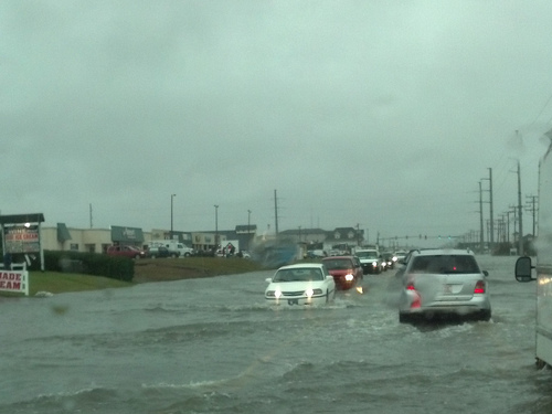Hurricanes feature image of flooded highway and submerged cars