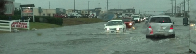 Hurricane feature image: flooded highway and cars underwater during Hurricane Sandy