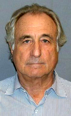Headshot of grey-haired Madoff wearing light blue collared shirt