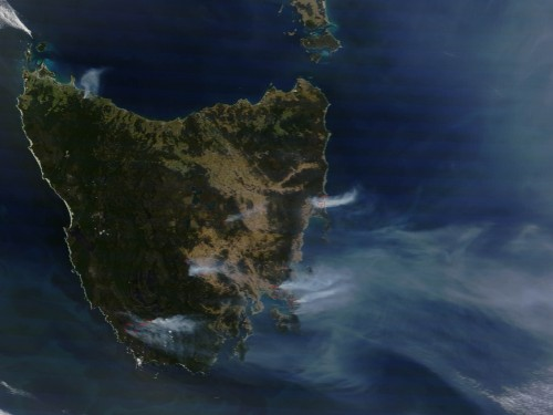 Satellite view of Tasmania shows small red circles and smoke plumes