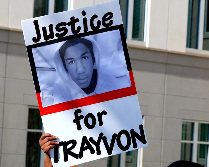 Protester holds aloft a photo of Trayvon Martin