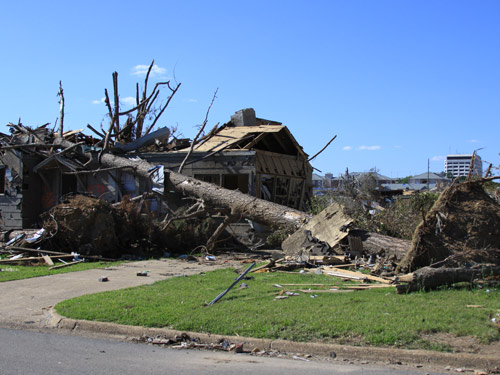 A tree was uproyouoted and fell upon devastated houses