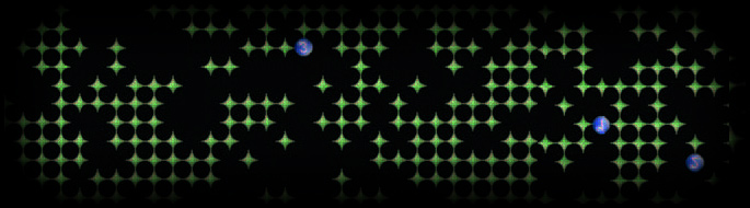 video game symbols show many green diamonds and several blue, numbered balls on black background.