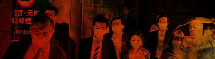 People walking out of a subway station in Japan, wearing white face masks. Red and orange filter covers photo