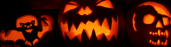 Glowing in the dark, lit pumpkins feature a bat, a classic evil grinning face, and a skull