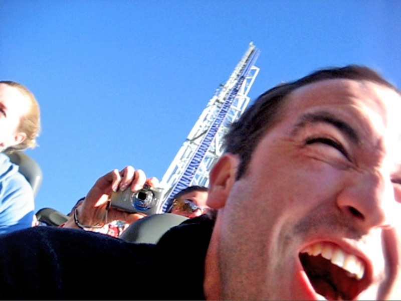 a man on a roller coaster, screaming