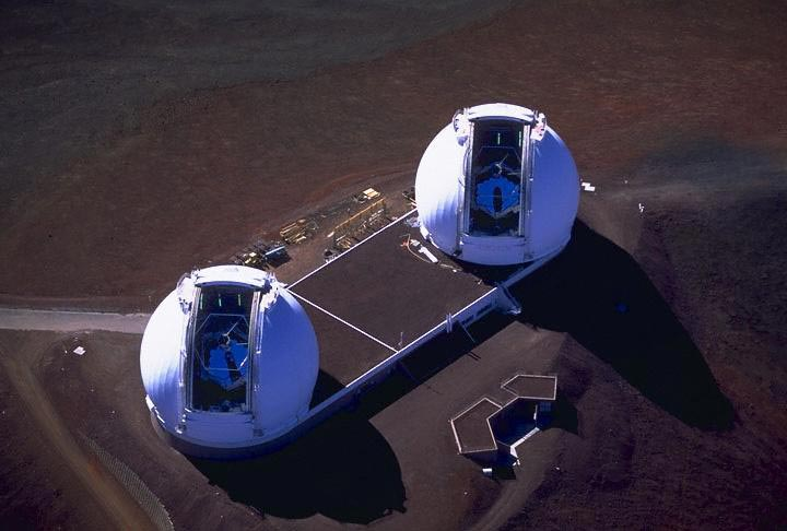 Aerial view of two big white domes with mirrors inside