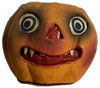 old, worn fake pumpkin Jack-O-Lantern with circle eyes and sharp teeth