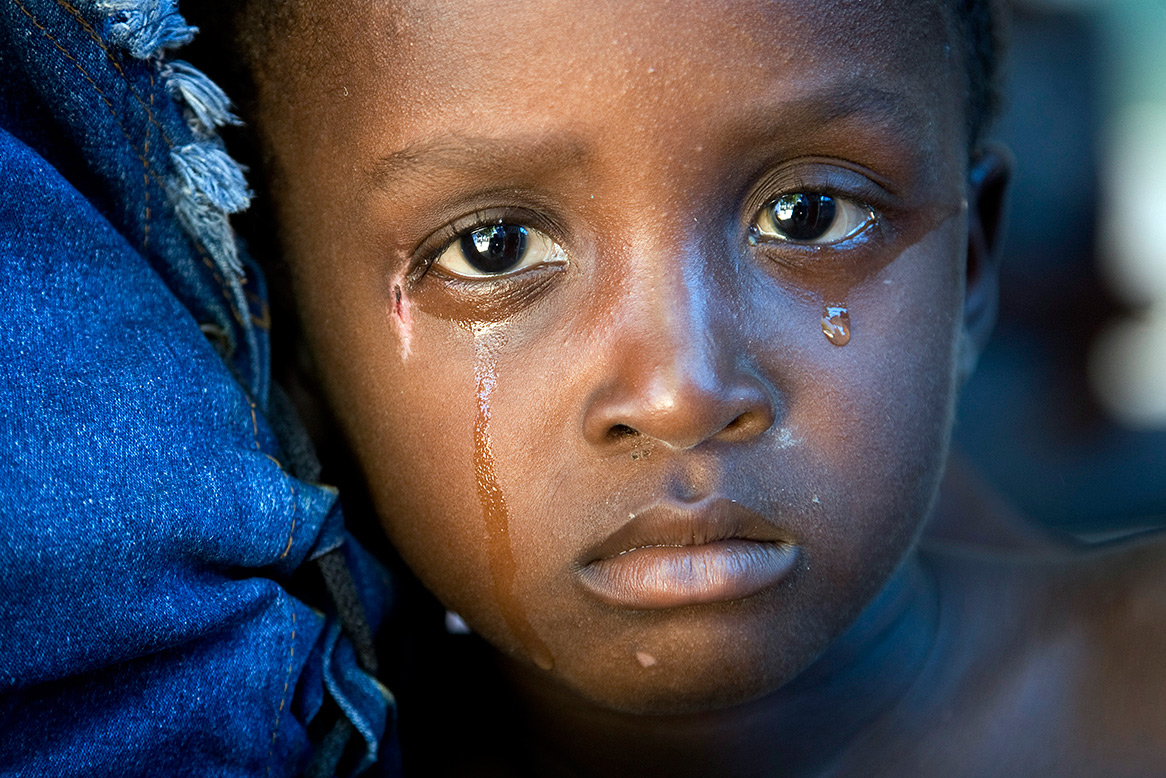 Sorrowful Haitian child, tears running down face