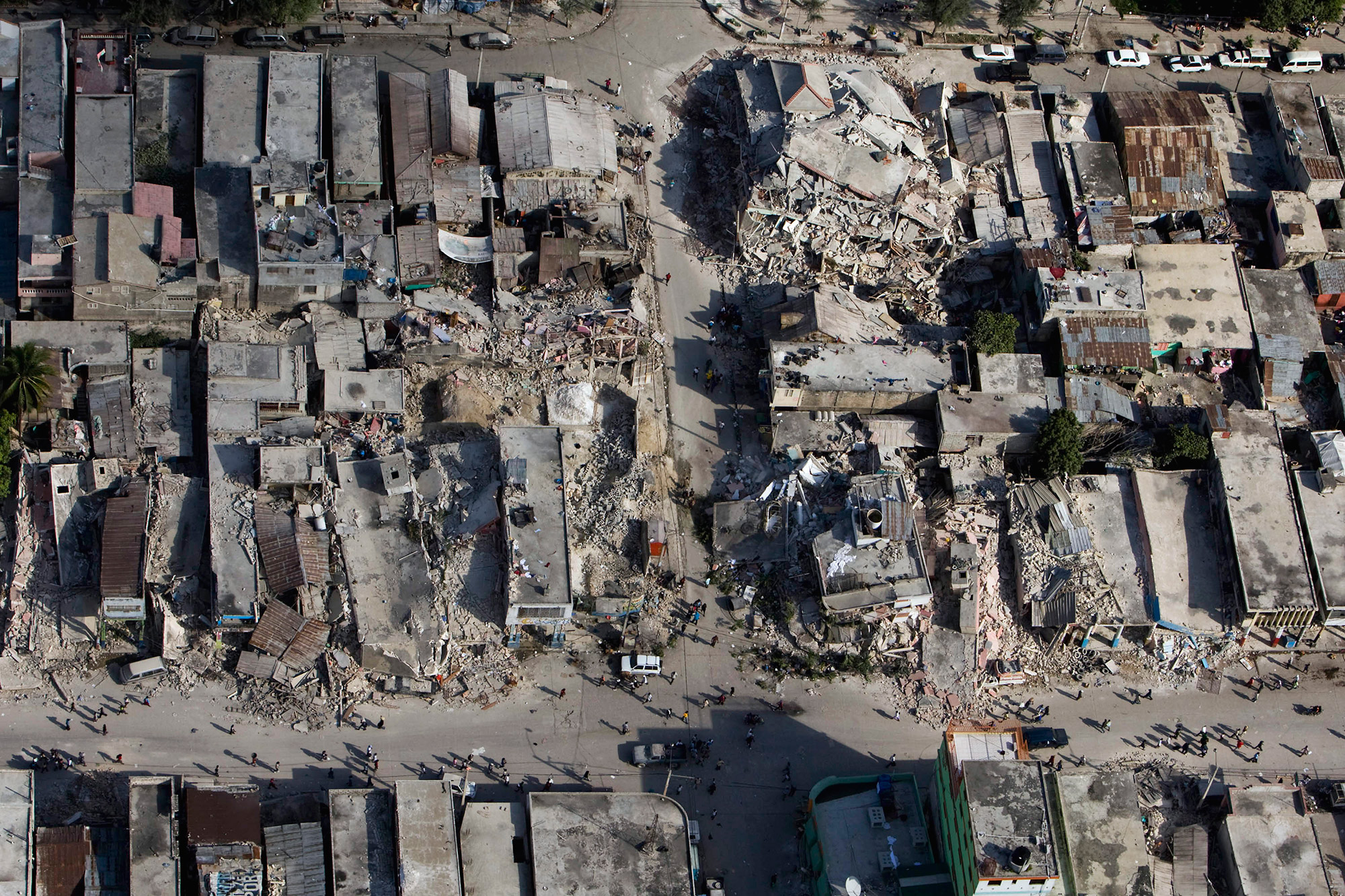 Aerial view of streets and collapsed houses
