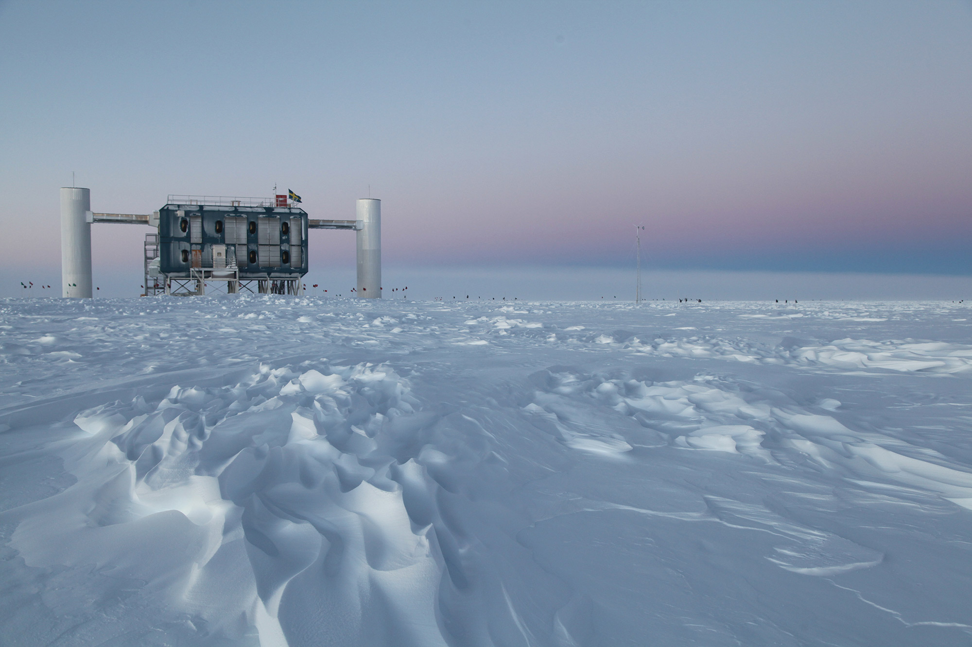 A building amidst snowdrifts on the vast Antarctic ice cap