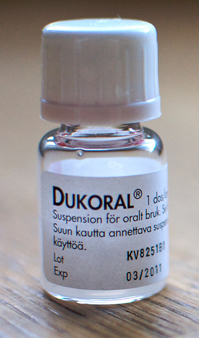 A vial of liquid with label DUKORAL on a desk