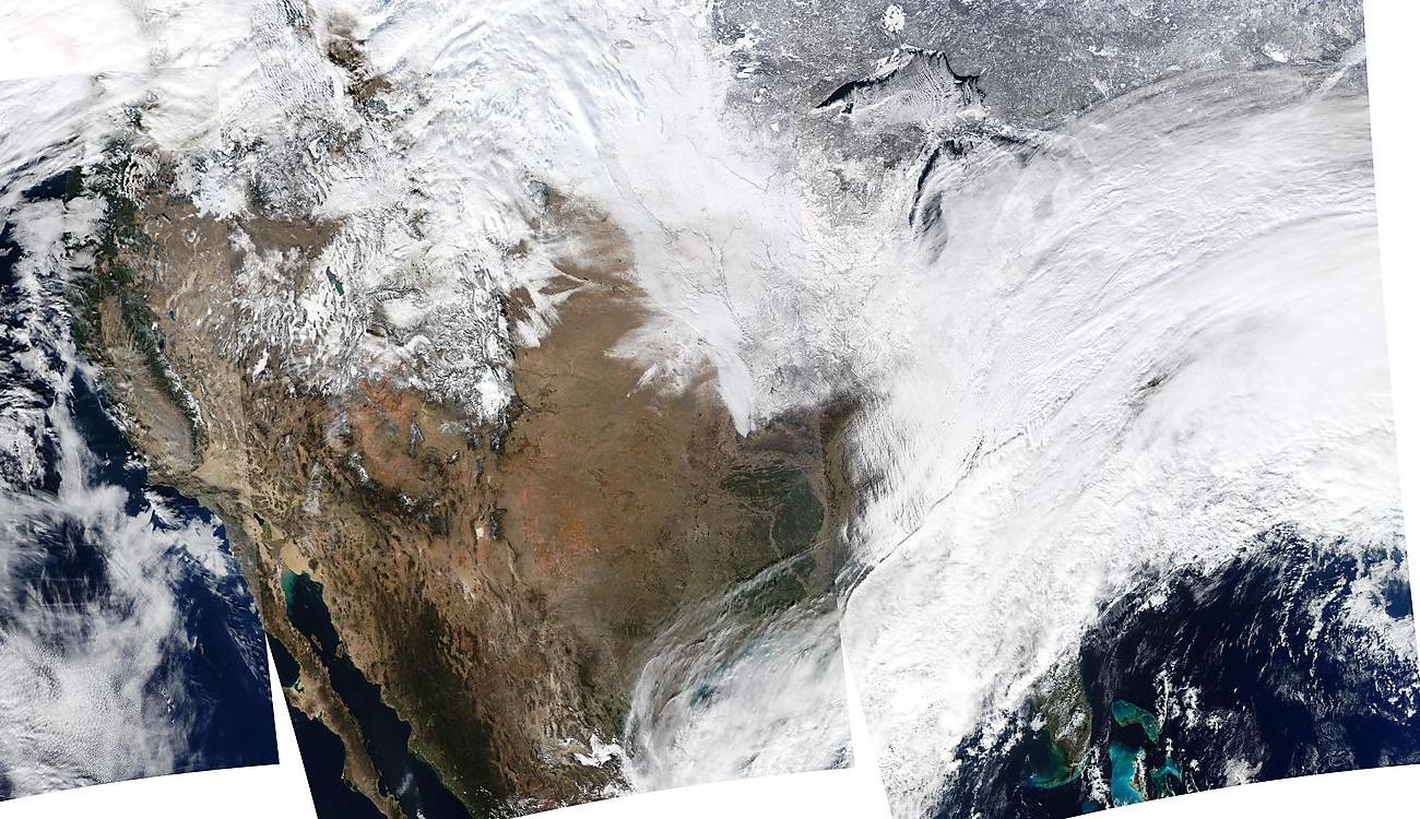 Satellite map showing snow covering the Midwest and Northeast in the United States.