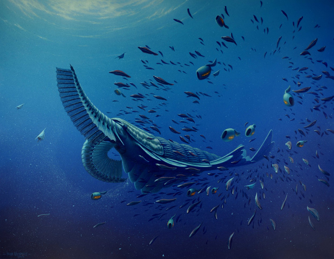 a shrimp-like creature swimming in the blue ocean with other smaller creatures around.