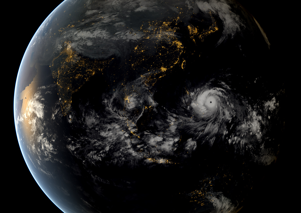 Giant circular hurricane shown on night-time image of Pacific and Indian Oceans.