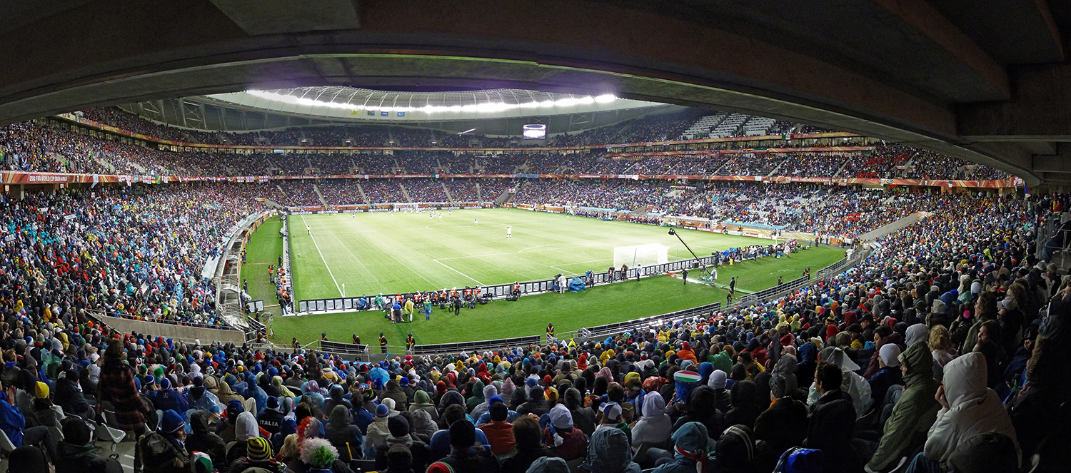 Panoramic photograph of crowded stadium at night