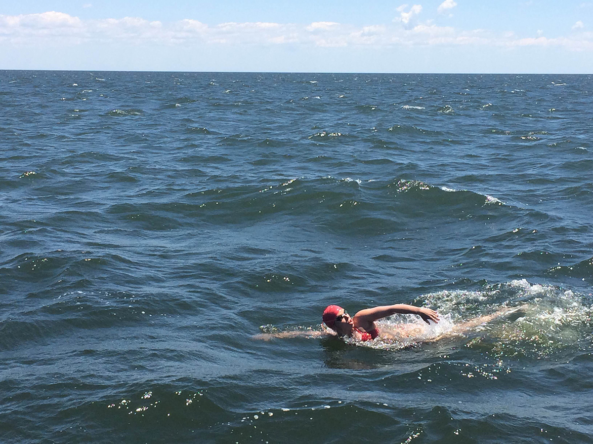 Photo of a woman freestyle swimming in open water