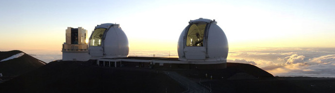Photo of two observatories above the cloud layer at dusk