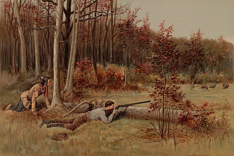 A prone man  aims shotgun, resting on log, at 3 turkeys; an Indian guide crouches behind him.