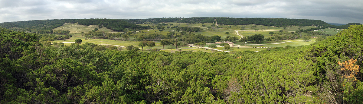 Panoramic view of Fossil Rim Wildlife Center shows an open, sprawling woodland and pastureland characteristic of central Texas countryside