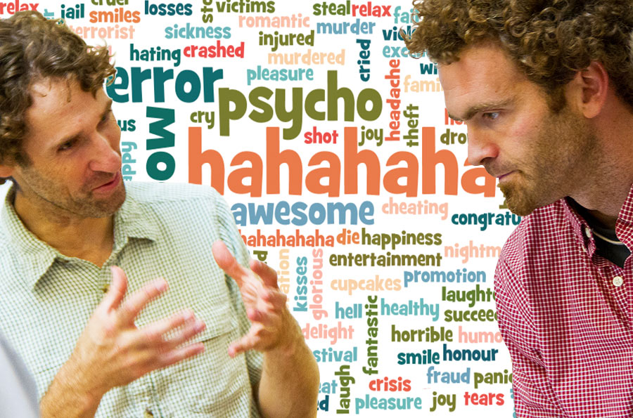 Photo of two men gesturing and discussing 'wordy' research; the happiest and saddest words used on Twitter float in the background space.