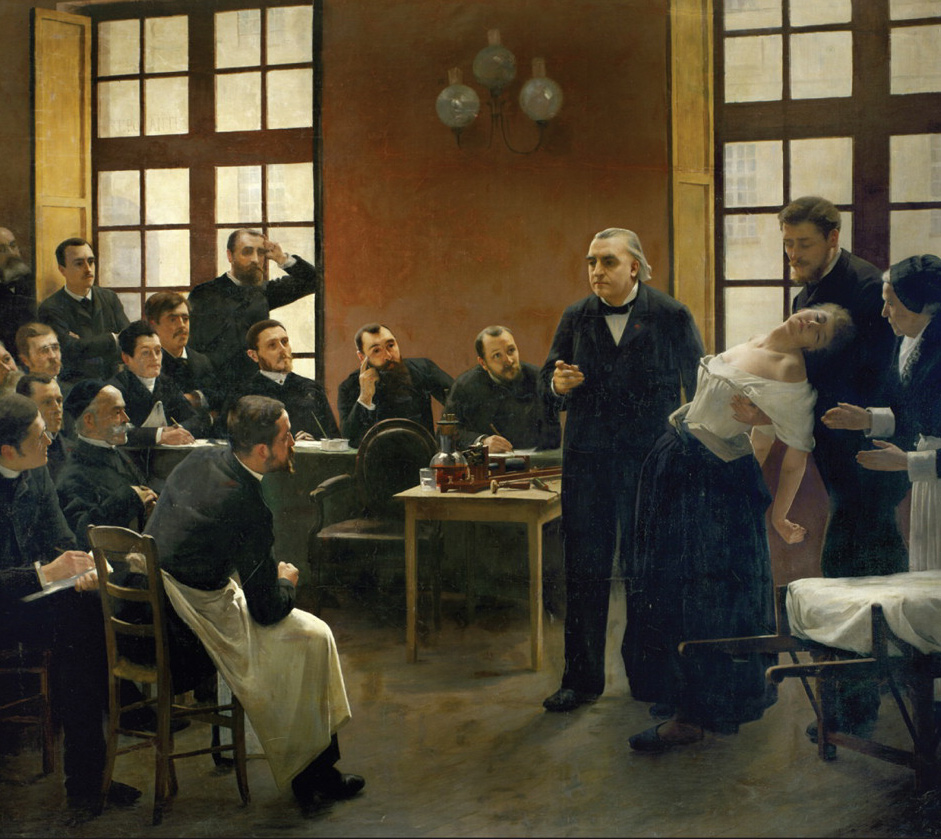 Late 19th century painting of a room filled with medical practitioners and scientists and an unconscious  woman held standing by her hypnotist from behind; the audience looks on inquisitively and take notes.